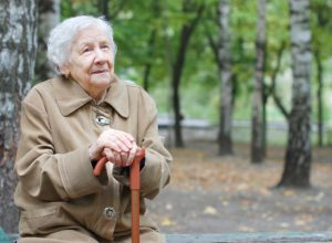 Older woman outside on bench