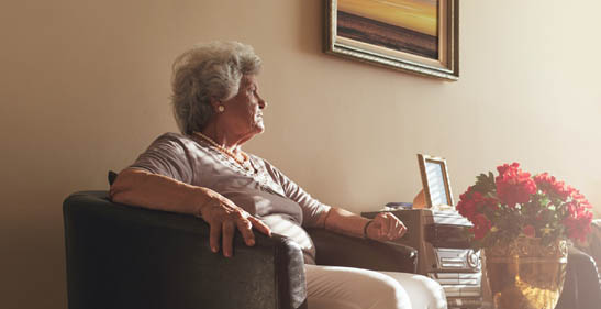 Older Adult looking out window